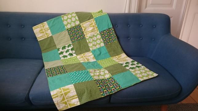 grønt patchworktæppe